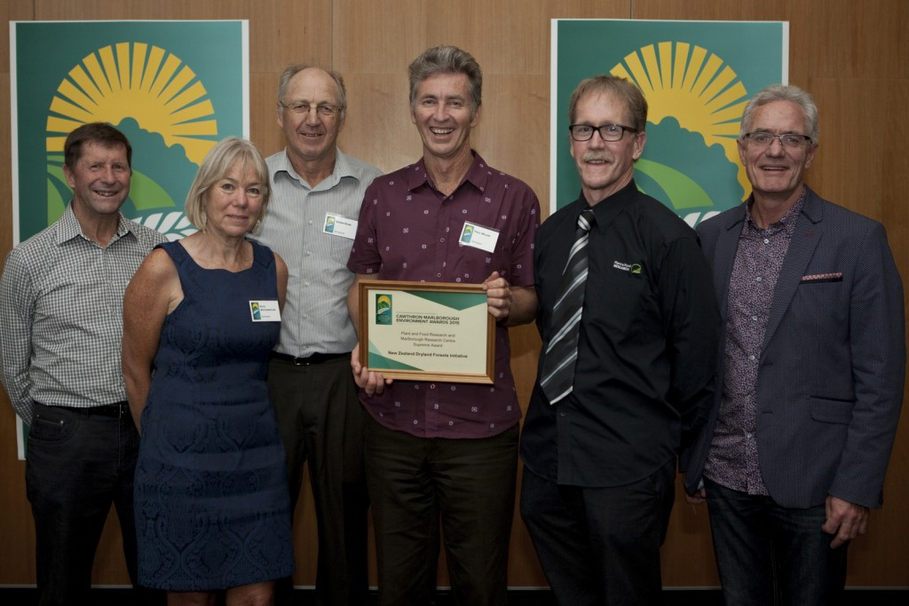 Paul Millen receives the Supreme 2015 Cawthron Marlborough Environment Award. He is pictured with members of the NZDFI team and representatives of Marlborough Research Centre Trust and 'Plant and Food Research' who are the Supreme Award sponsors. L to R: Edwin Pitts (MRC Trustee), Ruth McConnochie (NZDFI's tree breeder), Bernie Rowe MRC Trustee), Paul Millen (NZDFI's Project Manager), Rob Agnew (Liaison Scientist, Plant and Food) and Gerald Hope (Chief Executive, MRCT).